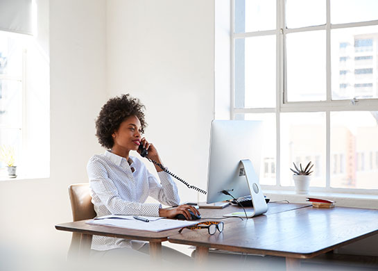 Professional on landline phone at work.