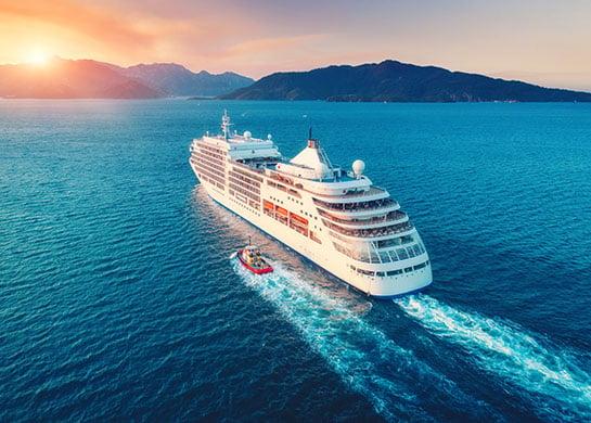 Cruise ship sailing through open waters.