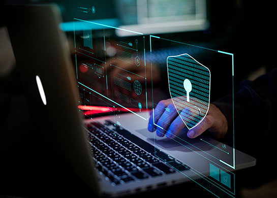 Person working with a secure network to avoid cyber attacks.
