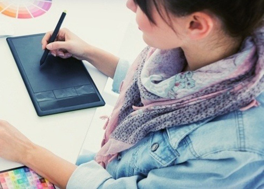 High angle view of an artist drawing something on graphic tablet at the office-971751-edited-042002-edited Featured Image