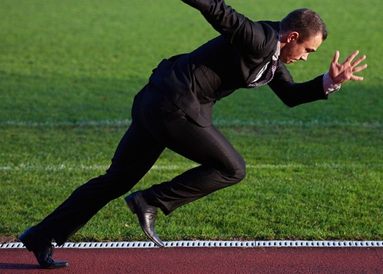 business man in start position ready to run and sprint on athletics racing track-226590-edited Featured Image